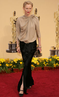 tilda-swinton-on-the-red-carpet-in-a-beige-draped-blouse-and-black-satin-skirt-both-by-lanvin