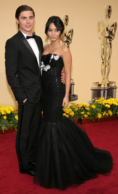 zac-efron-on-the-red-carpet-in-a-dolce-gabbana-tuxedo-with-a-vintage-rolex-watch-and-bally-shoes-vanessa-hudgens-in-marchesa1